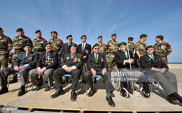 Members of the Kieffers commando Hubert Faure Yves Meudal Rene Rossey Jean Morel Maurice Chauvet and Leon Gautier attend a ceremony commemorating the...