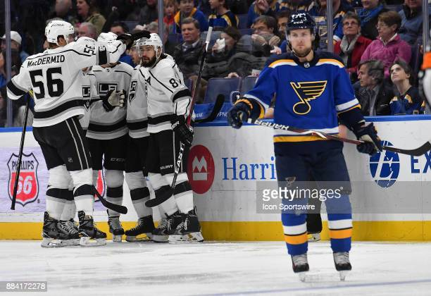 Members of the Kings celebrate a goal in the first period as St Louis Blues left wing Vladimir Sobotka skates away during a NHL game between the Los...