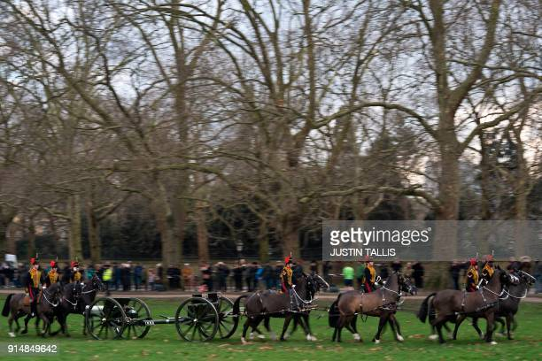 Members of the King's Troop Royal Horse Artillery gallop away after firing a 41 gun in Green Park in central London on February 6 2018 to mark the...