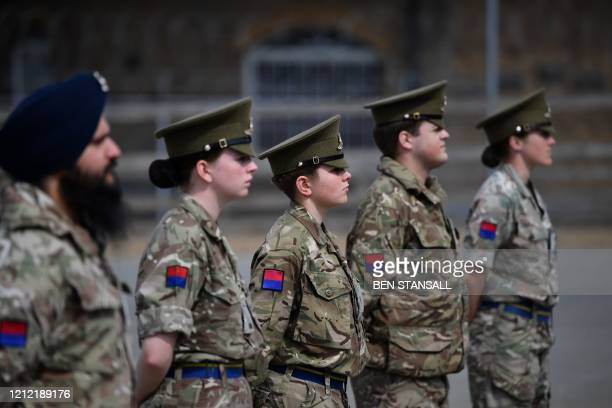 Members of the Kings Troop Royal Horse Artillery observe social distancing as they take part in a 2 minute silence to mark the 75th anniversary of VE...