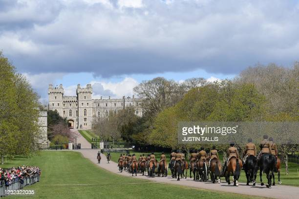 Members of the Kings Troop Royal Horse Artillery ride their horses into the grounds of Windsor Castle in Windsor, west of London, on April 15...