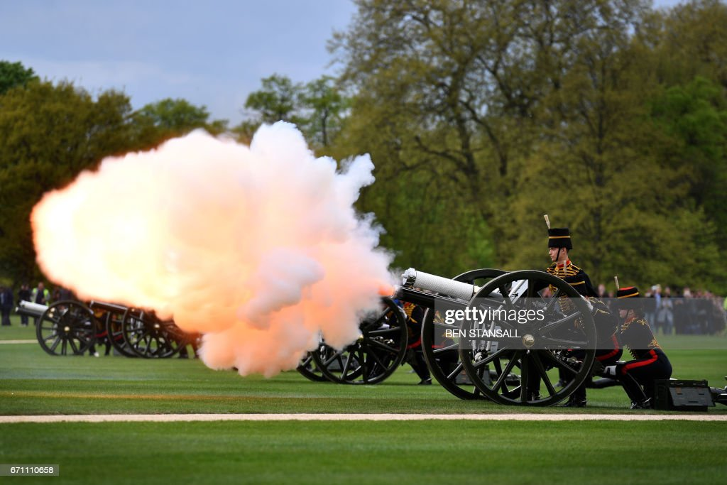 TOPSHOT - Members of the King's Troop Royal Horse Artillery take part in a 41 Gun Royal Salute to mark the 91st birthday of Britain's Queen Elizabeth II in Hyde Park, central London on April 21, 2017. /