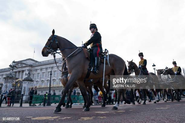 Members of the King's Troop Royal Horse Artillery trot away after firing a 41 gun in Green Park in central London on February 6 2018 to mark the 66th...