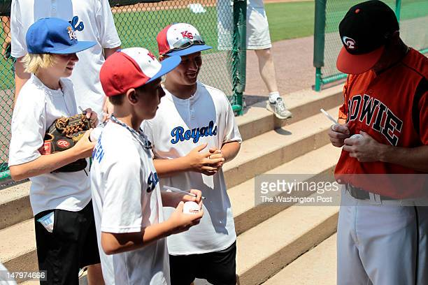 Members of the Kingson Royals Travel baseball team from Pasadena MD get baseballs signed in the dugout at the Bowie Baysox vs the Reading Phillies...