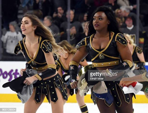 Members of the Knights Crew clean hats off the ice after William Karlsson of the Vegas Golden Knights scored his third goal of the game against the...