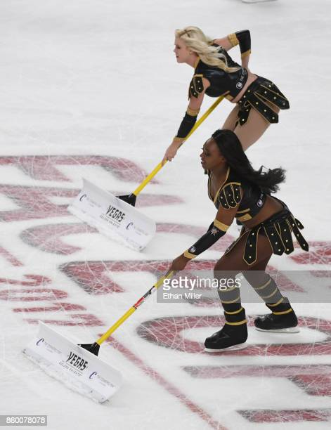 Members of the Knights Crew clean the ice during the Vegas Golden Knights' inaugural regularseason home opener against the Arizona Coyotes at TMobile...