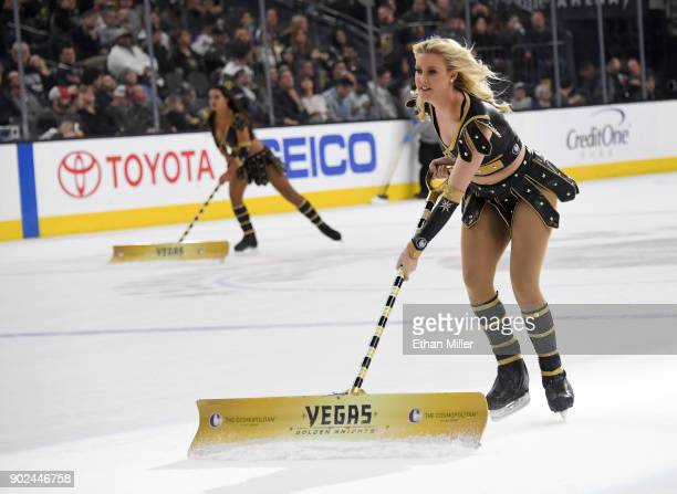 Members of the Knights Crew clean the ice during the Vegas Golden Knights' game against the New York Rangers at TMobile Arena on January 7 2018 in...