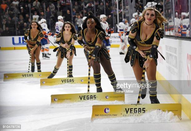 Members of the Knights Crew clean the ice during the Vegas Golden Knights' game against the New York Islanders at TMobile Arena on January 25 2018 in...