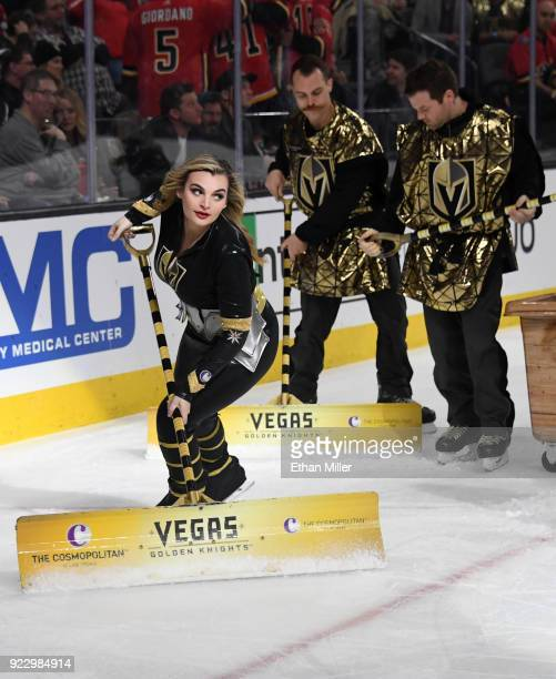 Members of the Knights Crew clean the ice during the Vegas Golden Knights' game against the Calgary Flames at TMobile Arena on February 21 2018 in...