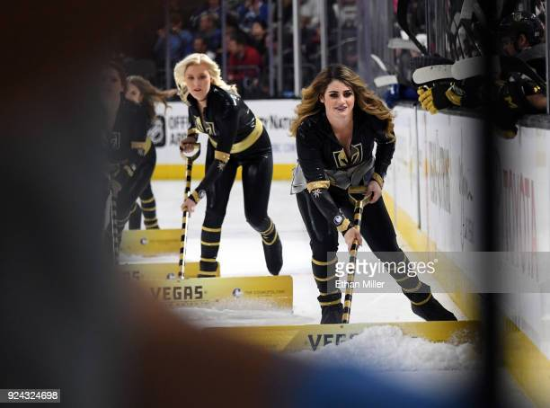 Members of the Knights Crew clean the ice during the Vegas Golden Knights' game against the Vancouver Canucks at TMobile Arena on February 23 2018 in...