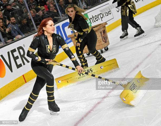 Members of the Knights Crew clean the ice during the Vegas Golden Knights' game against the Los Angeles Kings at TMobile Arena on February 27 2018 in...