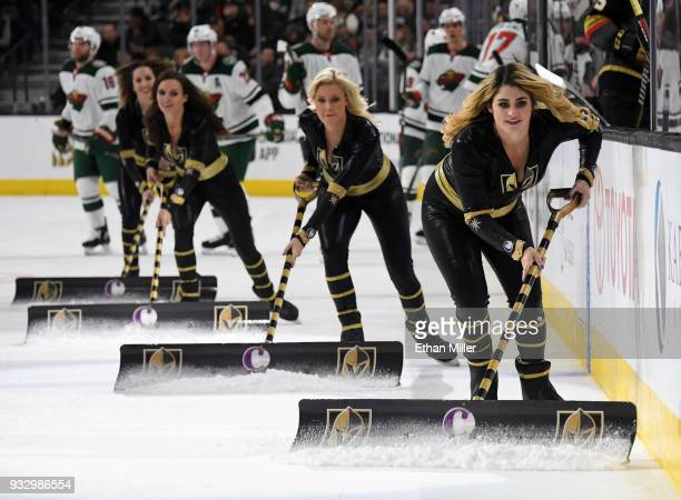 Members of the Knights Crew clean the ice during the Vegas Golden Knights' game against the Minnesota Wild game at TMobile Arena on March 16 2018 in...