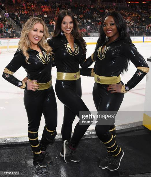 Members of the Knights Crew pose before the Vegas Golden Knights' game against the Calgary Flames at TMobile Arena on February 21 2018 in Las Vegas...