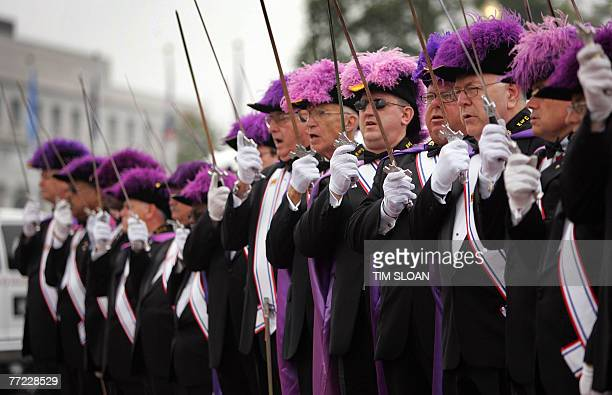 Members of the Knights of Columbus salute at the playing of the US National Anthem during the National Park Service and the National Columbus...
