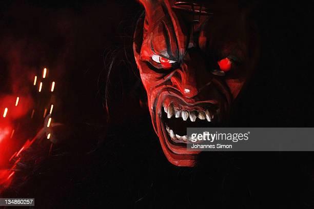 Members of the Koatlacker devil's association dressed as demonic creatures take part in a Krampus procession on December 4 2011 in Prad near Merano...
