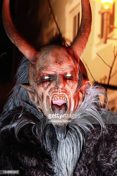 Members of the Koatlacker devil's association dressed as demonic creatures take part in a Krampus procession on December 4, 2011 in Prad near Merano,...