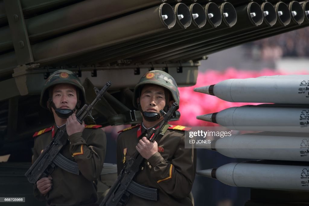 Members of the Korean People's Army (KPA) ride on mobile missile launchers during a military parade marking the 105th anniversary of the birth of late North Korean leader Kim Il-Sung in Pyongyang on April 15, 2017. North Korean leader Kim Jong-Un on April 15 saluted as ranks of goose-stepping soldiers followed by tanks and other military hardware paraded in Pyongyang for a show of strength with tensions mounting over his nuclear ambitions. / AFP PHOTO / Ed JONES