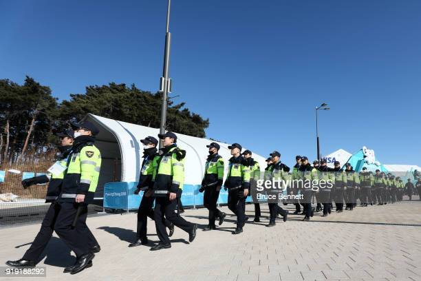Members of the Korean Police walk through the Olympic Park prior to the Men's Ice Hockey Preliminary Round Group A game on day eight of the...