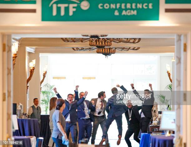 Members of the Kosmos sports group including Founder and Barcelona FC soccer star Gerard Pique celebrate during the ITF annual general meeting in...