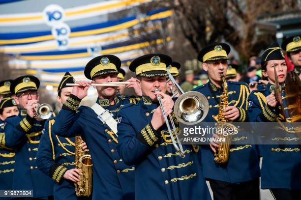 TOPSHOT Members of the Kosovo Security Force ceremonial band parade in the main square in Pristina on February 18 on the occasion of the 10th...