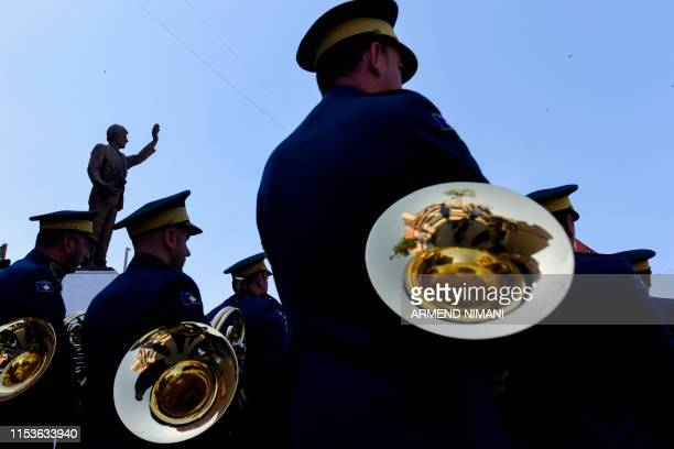 Members of the Kosovo Security Force perform next to a statue of former US President Bill Clinton during a ceremony marking the 4th of July as a...