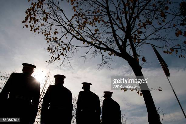 Members of the Kosovo Security Force stand guard as they take part in a ceremony at the orthodox cemetery in Pristina on November 11 during the...