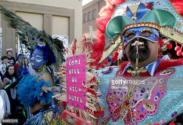 Members of the Krewe of Mondo Kayo Joe Perez of Tampa Florida right and Michelle Levine of New Orleans parade down StCharles Street in New Orleans...