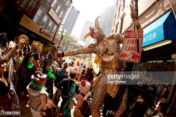 Members of the Krewe Of Saint Anne march down Royal Street Mardi Gras Day on March 05 2019 in New Orleans Louisiana Mardi Gras also called Shrove...