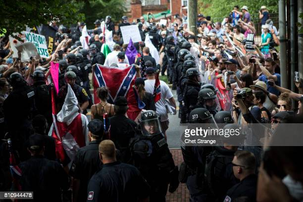 Members of the Ku Klux Klan are excorted out of a planned rally on July 8 2017 in Charlottesville Virginia The KKK is protesting the planned removal...