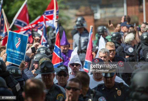 Members of the Ku Klux Klan arrive for a rally calling for the protection of Southern Confederate monuments in Charlottesville Virginia on July 8...