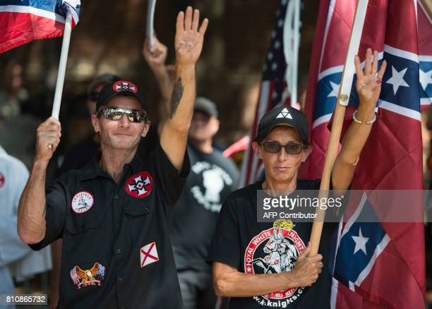 Members of the Ku Klux Klan gesture during a rally calling for the protection of Southern Confederate monuments in Charlottesville Virginia on July 8...