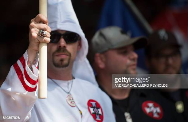 Members of the Ku Klux Klan hold a rally in Charlottesville Virginia on July 8 2017 to protest the planned removal of a statue of General Robert E...