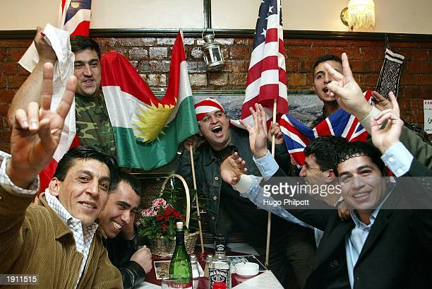 Members of the Kurdish community celebrate in the Tara restaurant in North London April 10, 2003. Kirkuk, the northern Iraq oil City was liberated by...