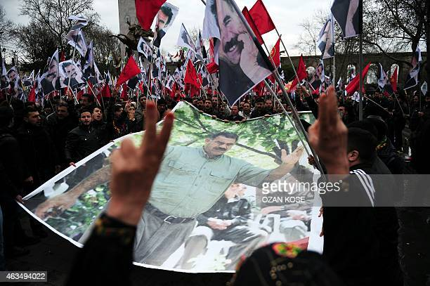 Members of the Kurdish community hold a banner depicting convicted Kurdistan Worker's Party leader Abdullah Ocalan during a protest calling for...