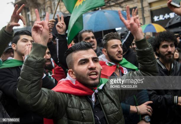 Members of the Kurdish community in Germany flah the sign of victory during a demonstration on January 18 2018 in Frankfurt am Main to protest after...