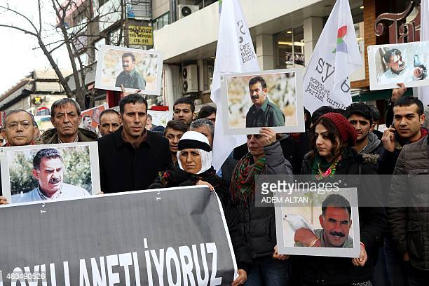 Members of the Kurdish community wave flags and banners of convicted Kurdistan Worker's Party leader Abdullah Ocalan during a demonstration calling...