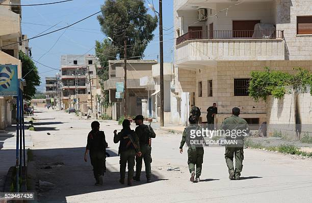 Members of the Kurdish internal security forces patrol the streets in the northeastern Syrian city of Qamishli on April 23 2016 Kurdish fighters and...