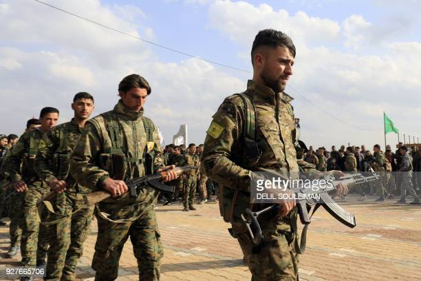 Members of the Kurdish People's Protection Units and Women's Protection Units attend the funeral of Kurdish fighters from the Syrian Democratic...