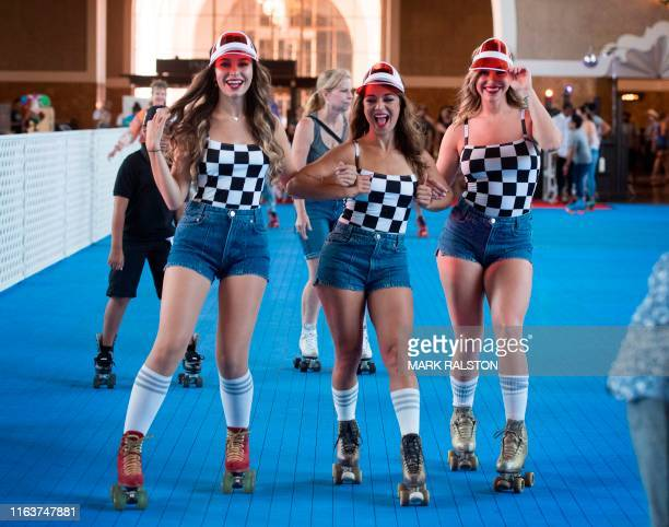Members of the LA Roller Girls troupe skate with the public after the historic Union Train Station was turned into a 1970's style disco skating rink...