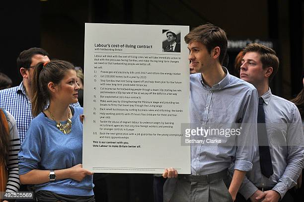 Members of the Labour party present Labour's cost-of-living contract during a campaign rally on May 21, 2014 in London, England. The rally comes in...