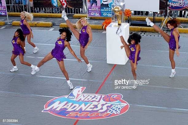 Members of the Laker Girls the official cheerleading squad of the Los Angeles Lakers team of the US National Basketball Association perform a dance...