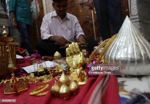 Members of the Lalbaugcha Raja ganesh mandal seperate the gold and silver offerings after Ganesh Visarjan They would start the auction of these...