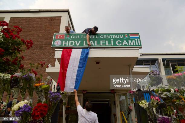 Members of the Laleli Mosque hand a Dutch flag on June 7 2018 in Rotterdam NetherlandsThe antiIslam group Pegida plans to roast pigs on a barbecue...