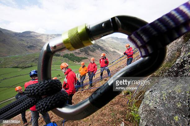 Members of the Langdale/Ambleside mountain Rescue setting up belays on a Team training in the Langdale Valley, Lake District, UK.