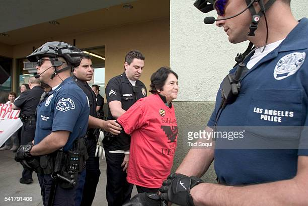 Members of the LAPD arrest religious, Los Angeles community, labor and elected leaders participating in civil disobedience at a Vons supermarket on...