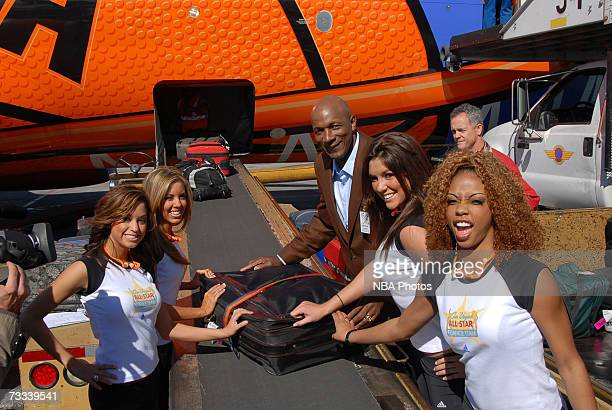 Members of the Las Vegas AllStar Dance Team help offload baggage during the Trading Places Southwest Airlines Event on February 15 2007 at McCarran...