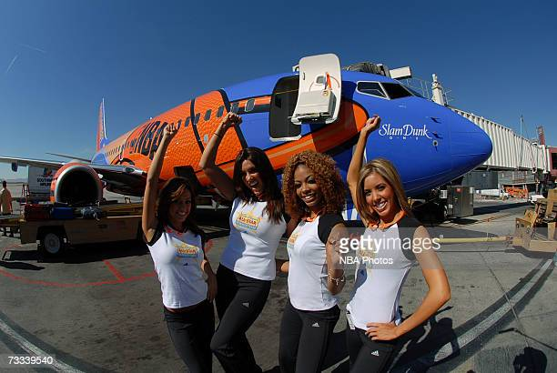 Members of the Las Vegas AllStar Dance Team pose in front of a Southwest Airlines Jet during the Trading Places Southwest Airlines Event on February...
