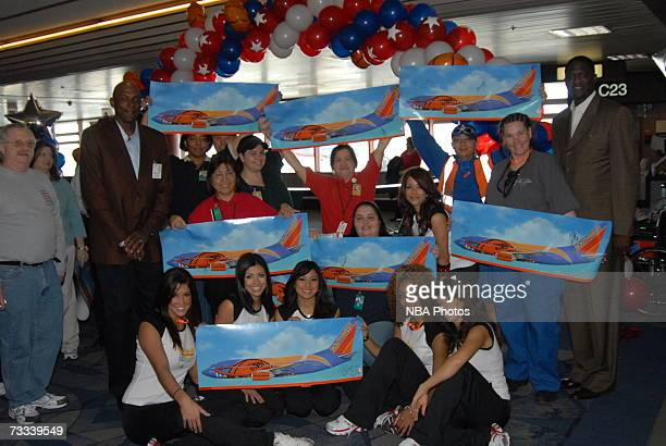 Members of the Las Vegas AllStar Dance Team pose with employees during the Trading Places Southwest Airlines Event on February 15 2007 at McCarran...