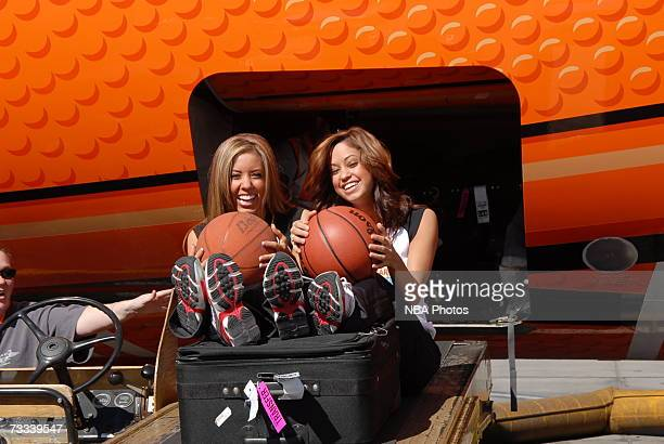 Members of the Las Vegas AllStar Dance Team ride down a baggage loader during the Trading Places Southwest Airlines Event on February 15 2007 at...