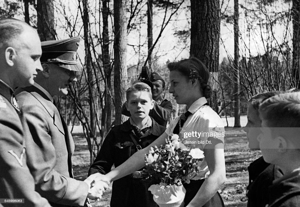 Members of the league of german girls bnd congratulating adolf members of the league of german girls bnd congratulating adolf hitler in the fuehrer voltagebd Image collections